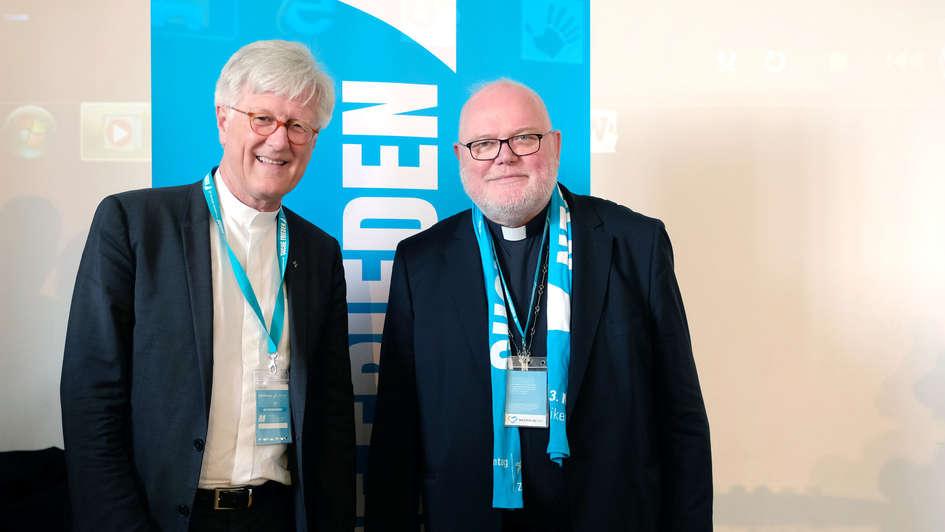 EKD-Ratsvorsitzender Heinrich Bedford-Strohm und Vorsitzender der katholischen Deutschen Bischofskonferenz Reinhard Marx auf dem Katholikentag 2018