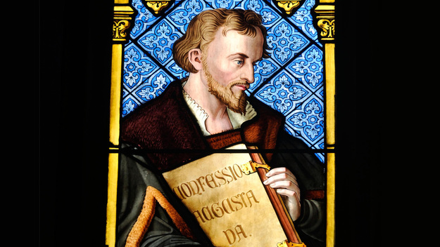 Church window shows Philipp Melanchthon with his 'Confessio Augustana'in the Heidelberger Peterskirche.